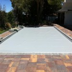 Recessed automatic cover system with gray pool cover fabric