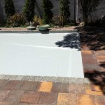 Custom paver lid concealing pool cover mechanism