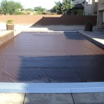 Recessed automatic cover system with a brown pool cover