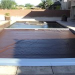 The brown pool cover fabric ties in nicely with the pool tiles