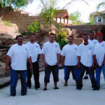 The Aqua-Safe Unlimited staff being supported by the strength of the pool cover
