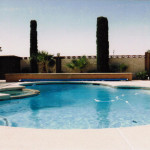 Above ground pool cover with the tracks installed at the widest part of the pool