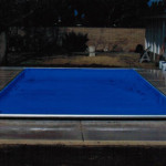 Recessed unit top track automatic pool cover in light blue