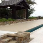 Tan pool cover fabric showing infinity edge