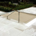 Automatic spa cover with tan fabric and custom lid