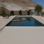 1/2 opened lap pool with a tan pool cover fabric