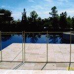 Beige brown premier fence installed in travertine tiles (special installation)