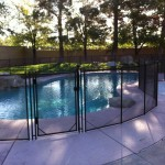 4' tall brown fence following the contour of the pool