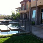 4' tall brown premier fence following the shape of the pool
