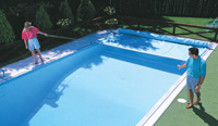 Depiction of operating the manual pool cover
