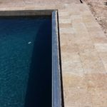 automatic pool cover concealed under custom deck lid